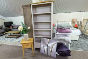 bookcase, shelf, home decoration, small table, side table, picture, canvas, pillows, blanket,